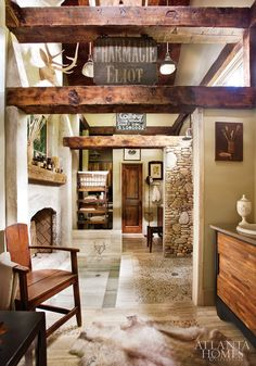 master bath in designer Bill Cook's North Carolina mountain cottage. That's a sunken soaking tub in front of the fireplace.