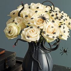 A bunch of white roses crawling with critters makes a pretty (and) disturbing centerpiece.