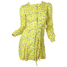 Early Cacharel Floral mini dress | From a collection of rare vintage day dresses at https://www.1stdibs.com/fashion/clothing/day-dresses/