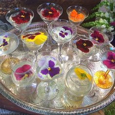 Champagne cocktails with edible flowers were served as welcome drinks in Port Jervis, New York. Event Designer: Julia Lake Parties Venue: Cedar Lake Estates