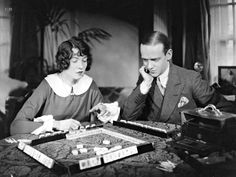 Adele and Fred playing a game in their London apartment, ca. 1921