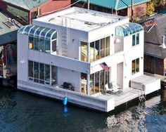 This sleek, contemporary houseboat by architect Jim Olsen weighs in at only 1,000 square feet. But with wraparound windows, epic skyline views, luxury amenities and of course waterfront access, this tiny gem packs a serious design punch.