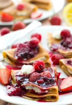 Filled with a tangy lemon cream cheese and topped with an unbelievable triple-berry sauce, these stunning crepes are a dream for any spring brunch! and Heavenly Oven Sweet Crepes Recipe, Homemade Crepes, Crepes Filling, Cream Cheese Crepe Filling, Berry Sauce, Crepe Recipes, Just Desserts, Breakfast Recipes, Breakfast Ideas