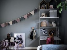 This Swedish kids room has dark walls, white furniture to contrast and you can find many classic Scandinavian brands. Kids Room Shelves, String Shelf, Dark Walls, Baby Bedroom, White Furniture, New Room, Play Houses, Bookcase, Interior