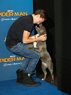 This is so cute, but it looks like his dog is going to bite his face off. LOL
