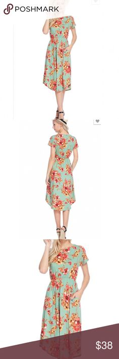NEW FIT & FLARE FLORAL DRESS New floral fit and flare dress. Elastic waistband. Round hem. Front pockets. 95% polyester/5% spandex 4 Bidden Boutique Dresses Midi