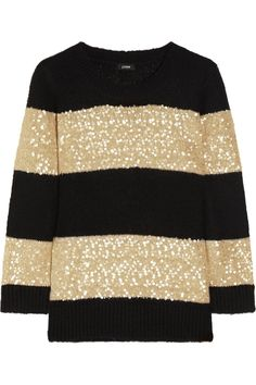 Ultra glamorous.  I so want to wear this sweater with a pair of skinny leg jeans and pumps.