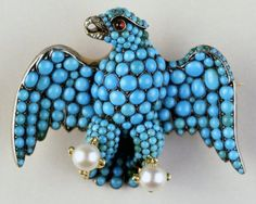 historysquee:  Eagle Brooch This brooch displays the Coburg Eagle of Prince Albert and is made up ofturquoises set in silver, with pearls in the claws, a diamond beak and a ruby for an eye, all backed in gold. Twelve of these were made to be given to the train bearers at the wedding of Prince Albert and Queen Victoria.
