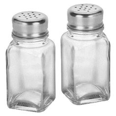 """The no-nonsense Salt and Pepper Shaker Set ANCHOR is made of glass and metal and lets you see exactly what you're getting. The identical salt and pepper set can also be used in the craft room to sprinkle different colors of glitter and then line them up in a row to make a pretty display on the shelf. Each shaker measures 3.8""""x1.5""""x1.5"""" (HxWxD)."""