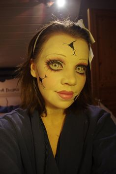 Cracked doll makeup tutorial--creepy! Her eye makeup is fabulous. Might pair this with an alice in wonderland costume for a little Tim Burton-esque flair
