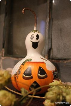 Happy ghost.  Spooked pumpkin.  Hand-painted on a gourd.