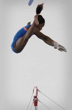 Gabrielle Douglas practices Friday July 6, 2012 at Chow's Gymnastics and Dance in West Des Moines with coach Liang Chow.
