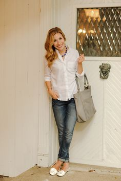 White button-up, jeans, white flats, colorful necklace.