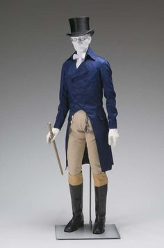 The mannequin here wears the typical outfit of a dandy. A dandy was a man during the Empire Period that took special care to his grooming and appearance. Beau Brummel is considered the first dandy.