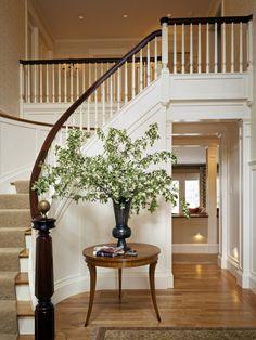 Dark handrails, white posts and oak floors