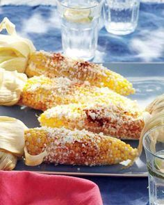 This Mexican-style grilled corn on the cob is slathered with sour cream and then sprinkled with tangy Cotija or feta cheese and paprika. If you like, serve lime wedges on the side.