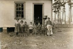 Tifton, GA 1909 Widowed mother of eleven children. All but the four youngest work in the cotton mill. Three months after this picture was taken the seven youngest children were sent to an orphanage. The family was never reunited.