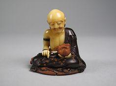 Netsuke of Wood Carver ~     19th century Japan ~  Wood and ivory