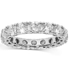 This exquisite womens eternity band is handcrafted in lustrous 18K white gold. Brilliant round cut diamonds are prong set all the way around the band and total to 4.00 carats. The frame measures to 3/16 inches in width and weighs 4.4 grams. $6,228.00