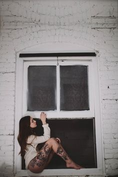 sitting in the window. leg tattoo. it should always be summer.