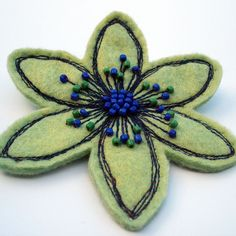 Green felt flower brooch with gorgeous embroidery and beaded centre