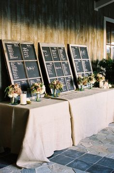Chalkboard Seating Chart ~ Pop those bridesmaid's bouquets in for double duty floral decor! Photography by jenfariello.com, Event Planning by eastonevents.com, Floral Design by patsfloraldesigns.com