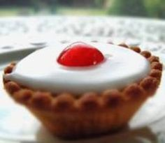 Cherry Bakewell Tartlets | DianasDesserts.com - a friend mentioned cherry bakewells and I was intrigued. Looks delicious.