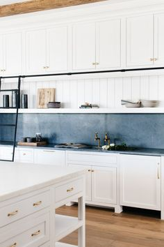 Check out this latest reveal of such a gorgeous kitchen! Library ladder in the kitchen + slate countertop and backsplash + white cabinets with brass hardware Kitchen Dining, Kitchen Decor, Kitchen Cabinets, White Cabinets, Kitchen Ideas, Beautiful Kitchens, Cool Kitchens, Dream Kitchens, Slate Countertop