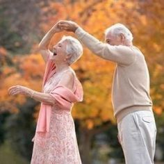 Old couple dance together