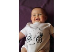 Organic 'Bunny On A Bike' Baby Grow. Price: £18.00, available from Etsy.