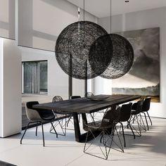 Woven orbs hang in the dining area.  Moooi Random Round ball Pendant Light
