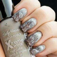 Rainy cloud nails using Sally Hansen Wet cement as the base. I sponged various grey polishes and some white to make the clouds. The stamp used for the trees is Winstonia hunter's life plate.