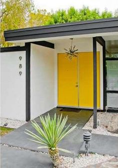 Midcentury Modern MCM Mid Century Palm Springs Yellow Painted Front Door Desert Style Starburst Light Pendant Entry black and white paint 1960s architecture house home retro atomic era