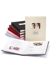 The Knot - One of my favorite guest book ideas. Made for a Fujifilm camera. Guests take a photo of themselves and insert it into the photo corners already on each page. They then sign the page with their well-wishes. Downside: Cost and only holds 30 photos. Could probably DIY for cheaper and include as many photo slots as desired.