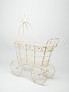 WIRE VICTORIAN CARRIAGE - Carriage measures 10x8x4 inches.  This is a great item to use for your next baby themed party. It is perfect for baby