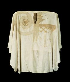 Africa | Robe.  Hausa peoples, Nigeria | Early to late 20th century | Cotton | Although this robe appears plain, it was intended as a display of wealth and status. Skilled craftsmen, laboring intensively, spun thread that was handwoven into narrow strips of cloth that were then sewn together by hand. A Koranic scholar and calligrapher created and laid out a pattern that often took one or two men several months to embroider.