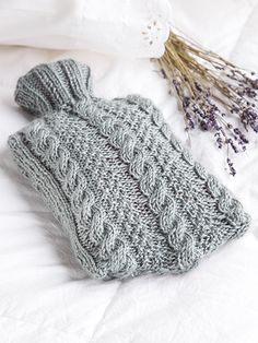 Free Knit Pattern Download -- This Jamieson Hot Water Bottle Cover, designed by KNC Design Team, is featured in episode 10, season 5 of Knit and Crochet Now! TV. Learn more here: https://www.anniescatalog.com/knitandcrochetnow/patterns/detail.html?pattern_id=36&series=2