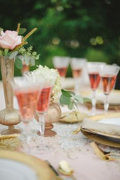 Aamodt's Apple Farm Wedding Photo Shoot Stillwater, MN party rental. Taryn Christine Photography. -- Rose wine in etched wine glasses for tabletop setting. Also includes gold charger plates and golf flatware and mercury glass vases with blush pink flowers. --