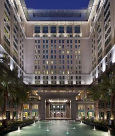 A 10-story majestic waterfall greets guests as they arrive at The Ritz-Carlton, Dubai International Financial Centre.