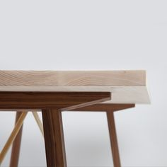 Simple detail of wooden table top on wooden legs. The Series Two table by British furniture maker Another Country.