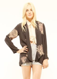 """Silky draped jacket features side pockets and coral print. By Something Else. 100% Viscose. Length: 28"""""""