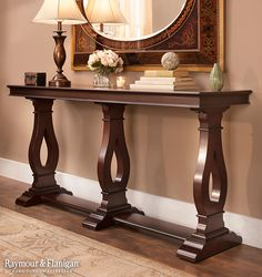 A console table is perfect for any entryway, living room or dining room, so you can show off your favorite collectibles, family photos and more. This Patmore Console Table is new to our collection.