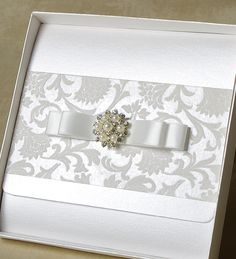 Another pocketfold representative of the range is Amelia design. Striking embellishment with pearls and rock-crystals combined with the opulent volumetric applique draw the eye while superior pearlescent paper background provides the ultimate in quality.