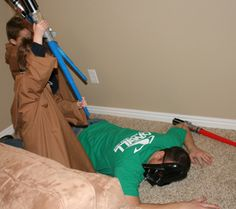 Fight Darth Vader with light sabers made from pool noodles, duct tape and electrical tape.