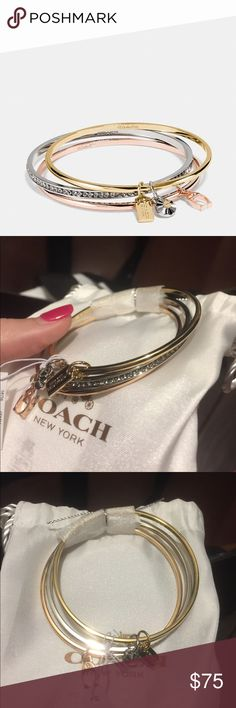 Signature 'C' Coach Bangle Set Never been worn. Tags still on them! Needs a good home! Coach Jewelry Bracelets