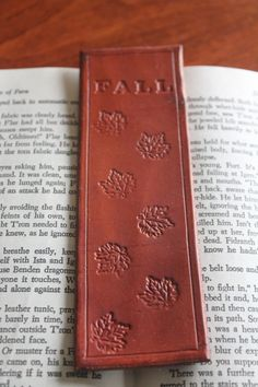 Hand stamped, hand dyed, genuine leather bookmark  The Dye pictured in the sample above is Tan  Bookmark is 5.5x1.75 inches  The Natural color