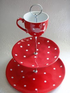 Dotted cup cake stand.  What is that center thing holding it all together?  I'm guessing it's something re-purposed, but I can't place it.
