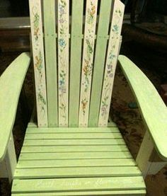 Painted adirondack chair with  garden/flower quotes hand-written on the soft green slats
