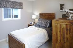 Spare bedroom or a children's bedroom in the Orion II showhome in King's Heights in Airdrie by Shane Homes. New Homes, House Design, Bedroom, Furniture, Home Decor, Decoration Home, Room Decor, Bed Room, Bedrooms