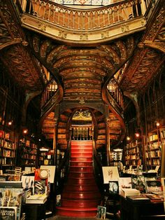 This divine neo-gothic bookstore, opened in 1906, contains what we consider to be the ultimate definition of a stairway to heaven. Livraria Lello, Porto, Portugal. (from nolollygagging)